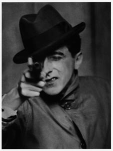 Cocteau with Gun, 1926: Berenice Abbott/Commerce Graphics.