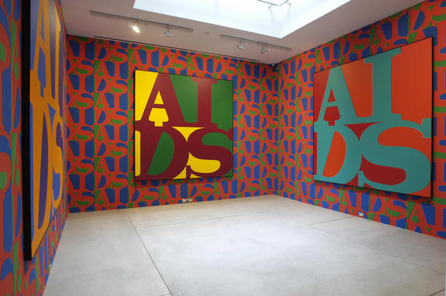 General Idea: AIDS (1987): Silkscreen wallpaper, various dimensions and AIDS (1988), acrylic on canvas. Installation view. Gift of Robert and Lynn Simpson, 1997. Photo: Carlo Catenazzi. Images courtesy the Estate of General Idea and the Art Gallery of Ontario, Toronto.