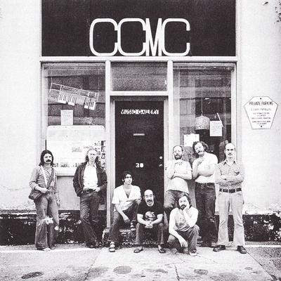 Cover of CCMC LP Volume One, picturing the group in front of the Music Gallery, Toronto (1976): Left to right: Peter Anson, Michael Snow, Casey Sokol, Nobuo Kubota, Bill Smith, Graham Coughtry, Al Mattes, Larry Dubin.