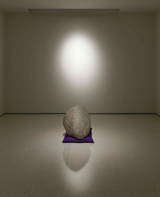 Relatum (formerly Perception A), 1969/2011: Stone, cushion, and light. Cushion, approximately 8 x 45 x 40 cm; stone, approximately 35 cm high. Private collection.